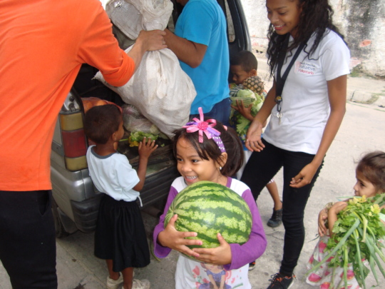 Look how happy these children are to receive food