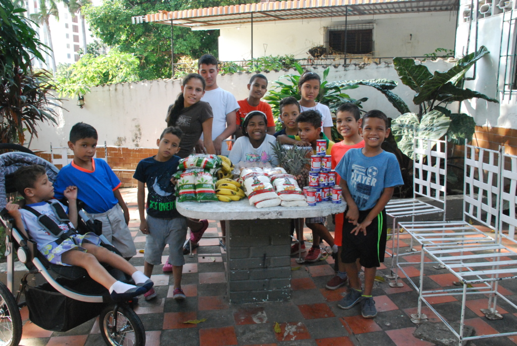Orphan Children Celebrate SAI Food Delivery