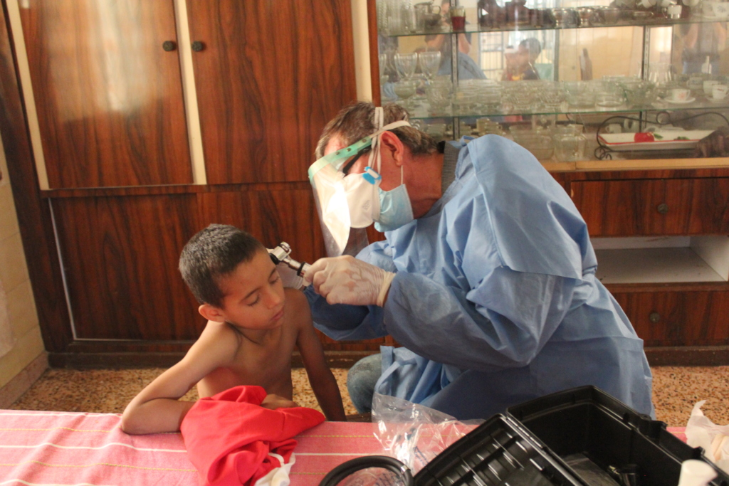 SAI Medical Assistant Examines An Orphan Boy.