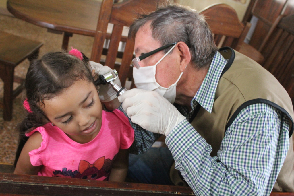 SAI Medical Assistant Examines An Orphan Girl.