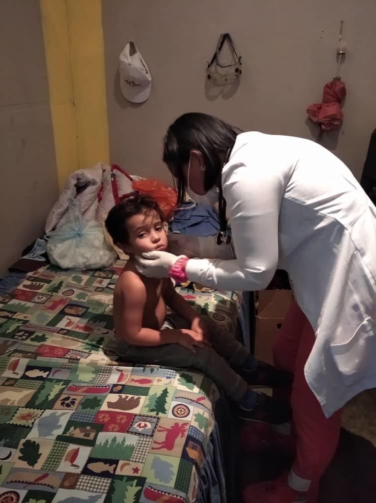 SAI medical assistant examines orphan boy