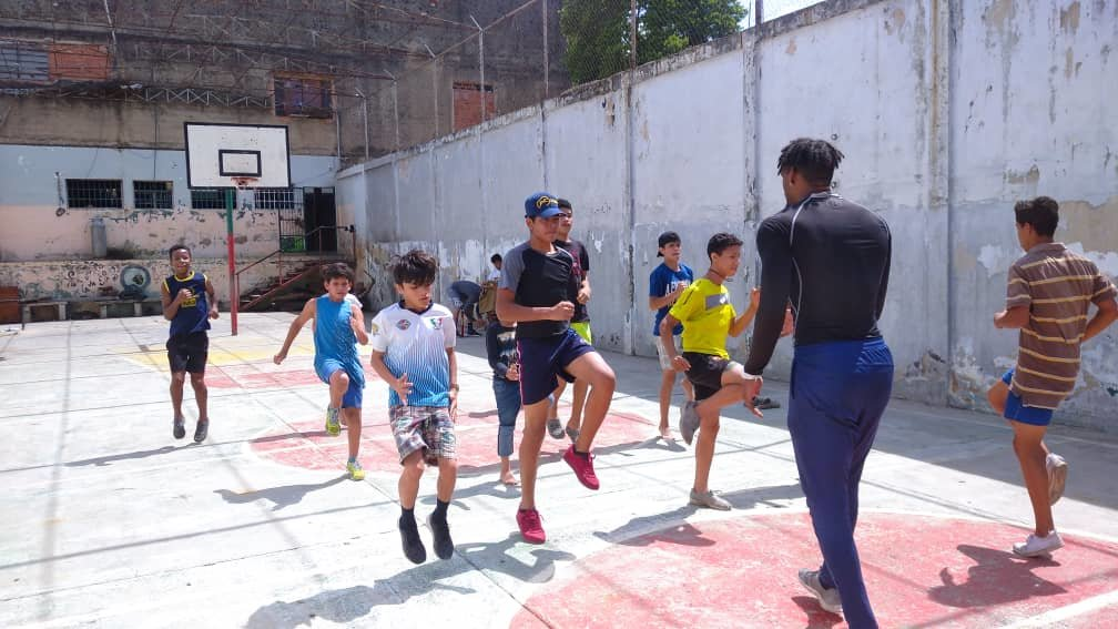 Orphans receiving physical fitness from trainer.