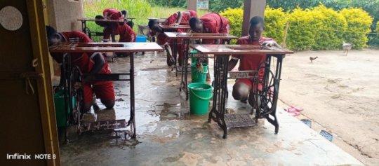 Girls servicing & maintaining sewing machines