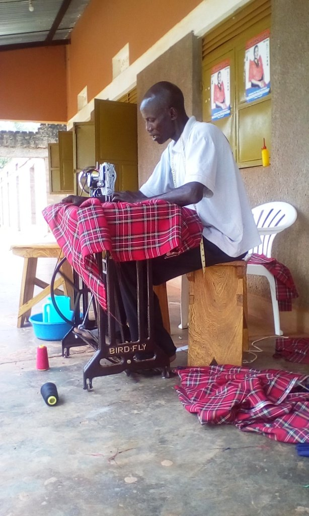 KIFA Tailor busy working on the uniform