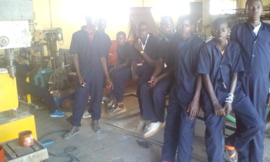 Boys skilled to maintain & service machines