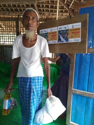 An Old Man with Food Items distributed by CHCS