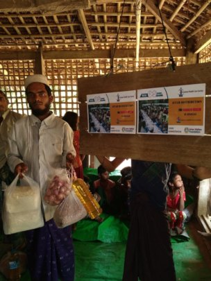 A Family receiving Food Items