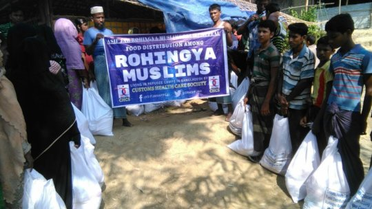 Ration Packets being Handed Over among Refugees