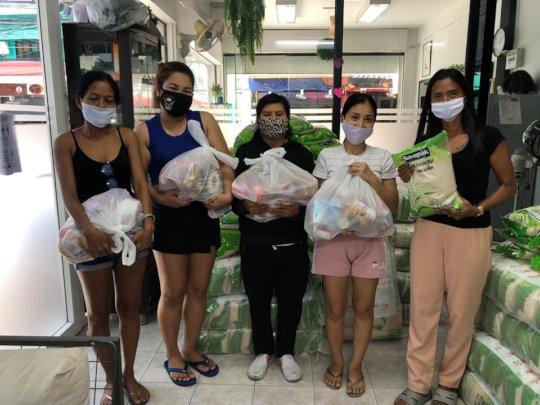 Women picking up food bags