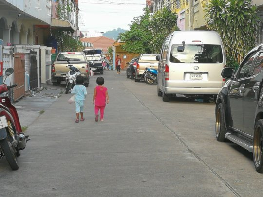 Our kids exploring the street where we stay