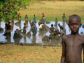 Boy standing in front a river in Juba