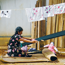 Photo: Augustina Lopez weaving. By Tom Feher.