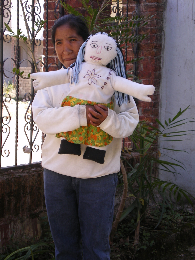 Odelia with doll she made as part of the bilingual literacy prog