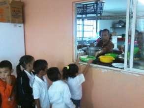 Volunteer Cooks in Elementary School Cafeteria