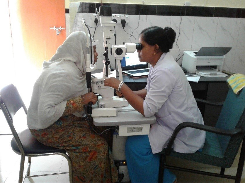 Kalpana checking the eyes of a patient