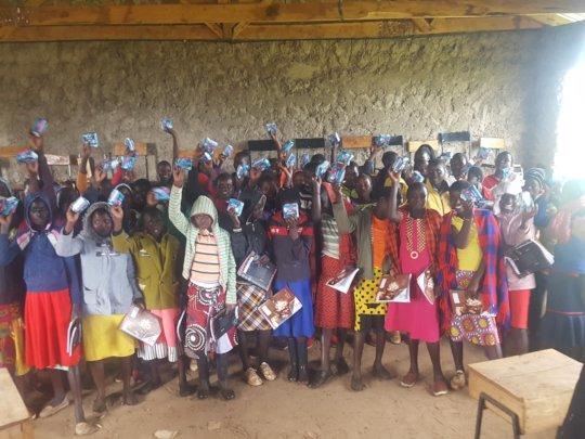 Girls displaying their sanitary napkins.