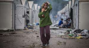 Refugee woman in horrific camp