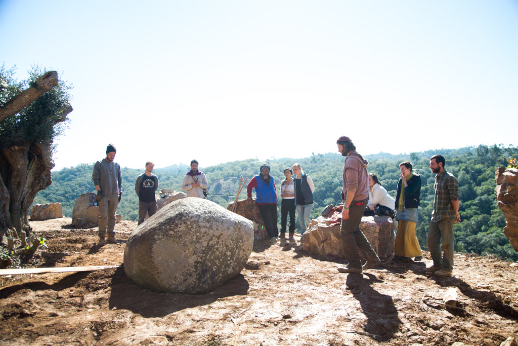 Moojibaba and the team placing large stones