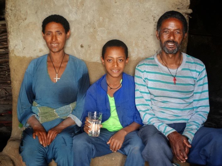 Alemnesh with her husband and of their children