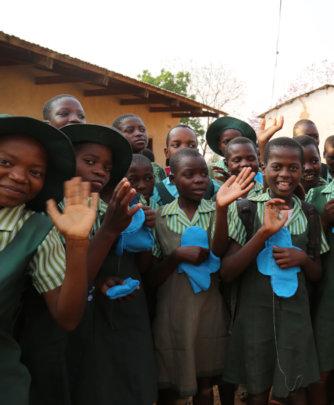Girls receive menstrual hygiene products