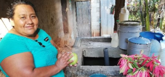 Felicita showing her future water source at home