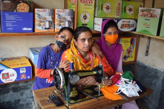 Sahinoor sewing masks with Shourav (L) & Shanta (R