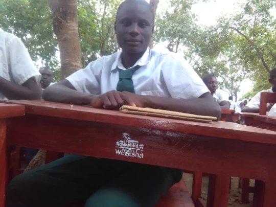 Amahoro Secondary Student at new Proj Wezesha desk