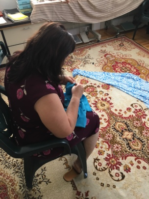 Merita is learning new skills, how to make clothes