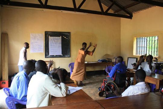 Gulu Coaches learning Sign Language