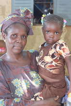 Health Worker Ami Keita with her youngest daughter