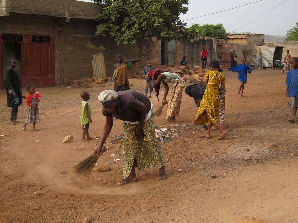 Women in Sikoro sweeping the trash