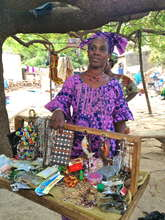 Aicha used a small loan to purchase goods to sell