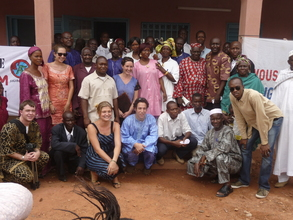 The MHOP team gathers in front of the new clinic
