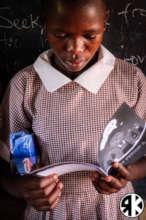 Standard Seven Student after receiving her Kit