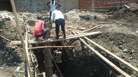 Erecting foundation pillar.