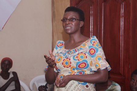 Parfaite welcomes HIV+ beneficiaries to clinic.