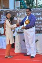 A girl student getting a recognition award