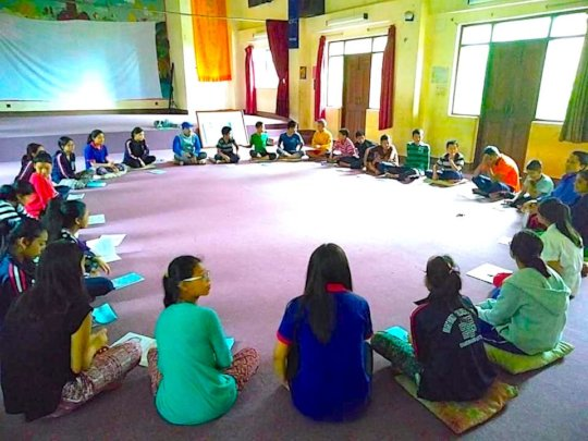 Students in Nepal participate in a healing circle