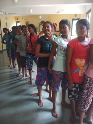 Girls in a queue for their checkup
