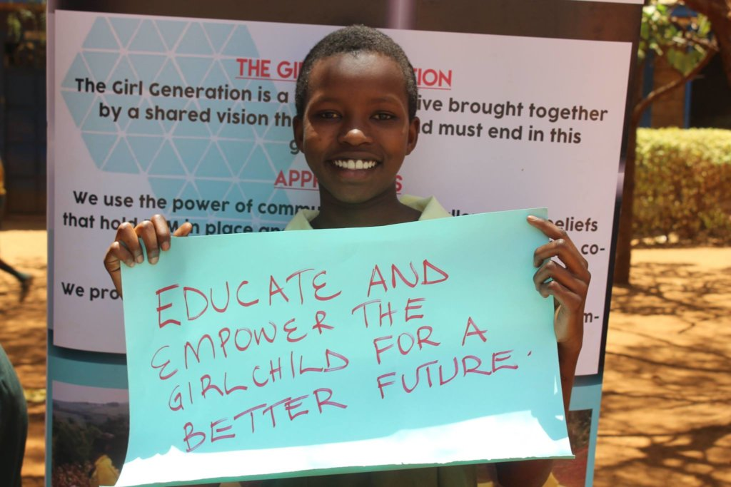Girl showcasing a message after school outreach.
