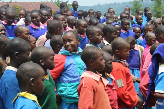 Happy faces during a school outreach by HFAW