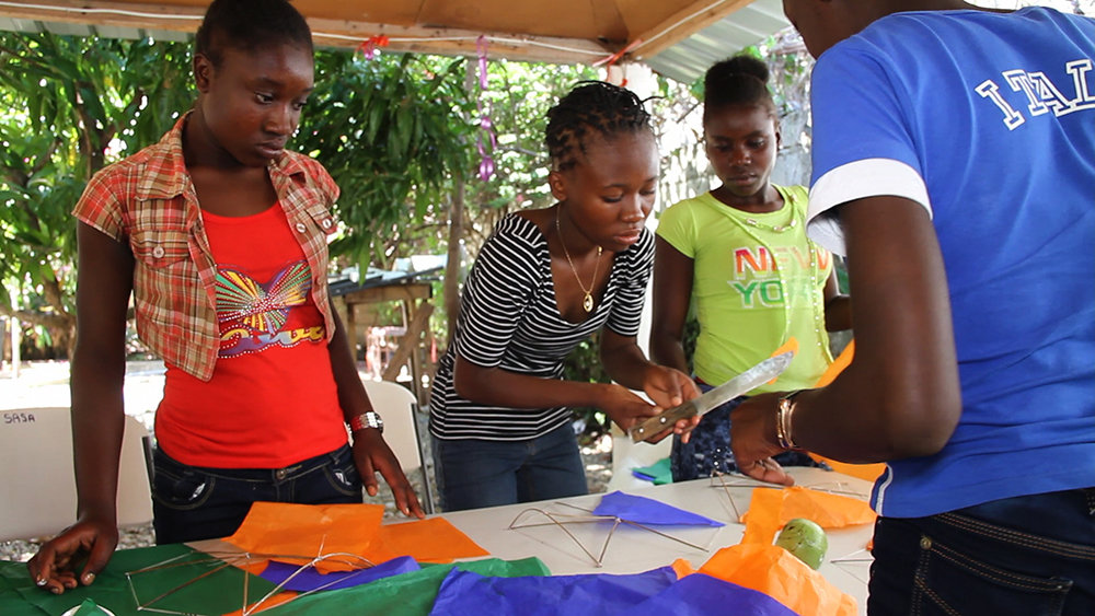 Making kites, traditionally a boy-only activity.
