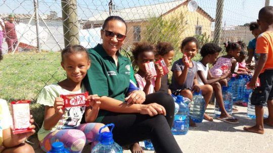 Children Recieved Water and a Delicious Chocolate