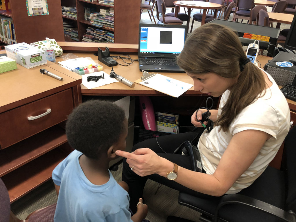 Our audiologist explains screening to young child