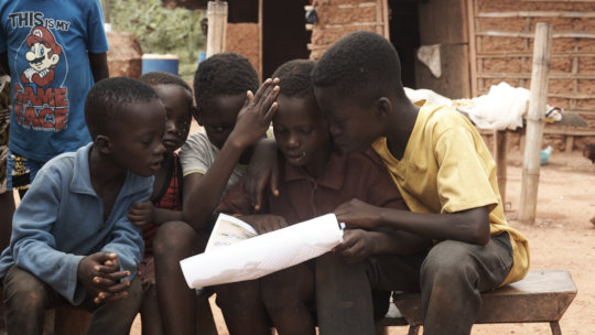 Community children engage with handwashing poster