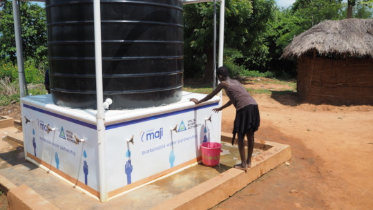 Sedorm Community, teenage girl draws water