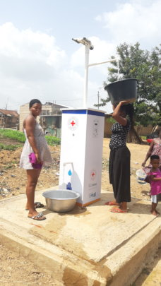 Women conveniently draw water from standpipe