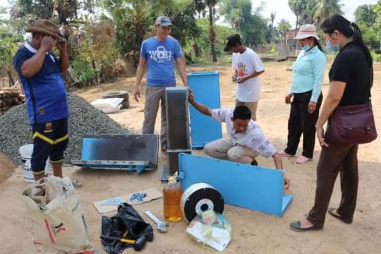 Koy Thea constructing BioSand Water Filters