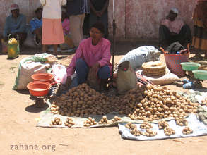 Potato vendor in a market in Madagascar