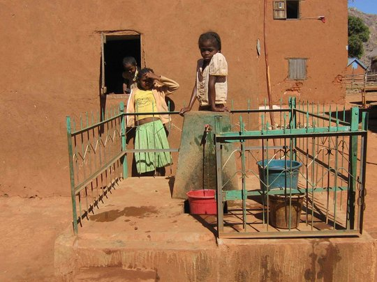 Communal water faucet with new fence (2011)